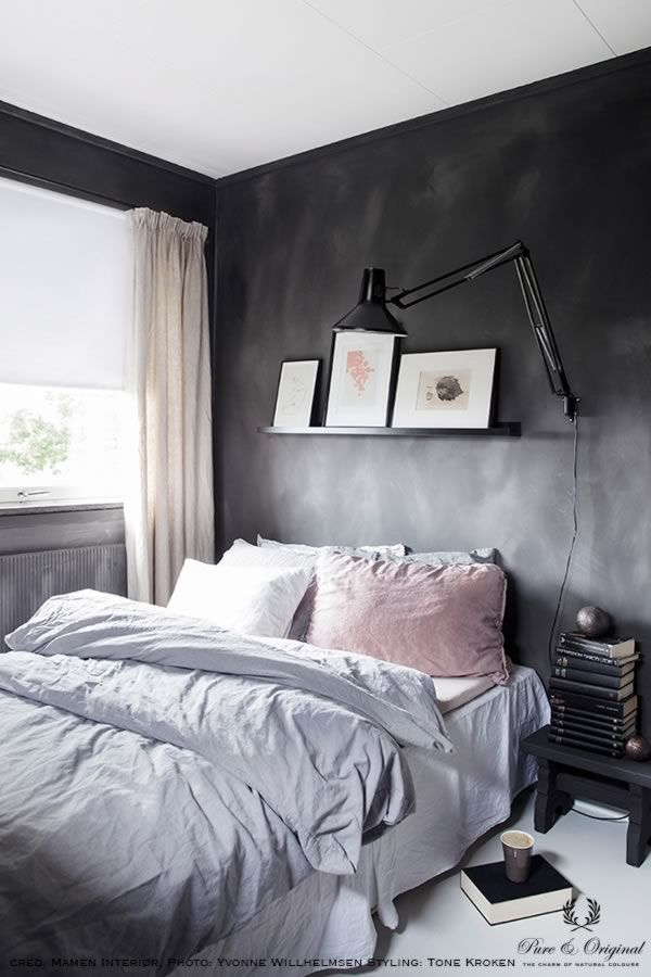 Fresco lime paint in the colour Black Truffle, applied behind the bed