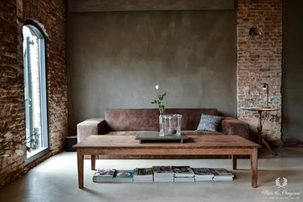 Fresco lime paint in the colour Deep Earth, applied behind the couch in the living room