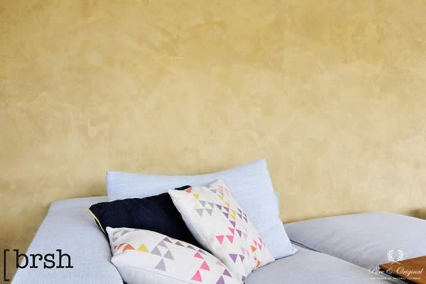 Marrakech Walls in the colour Provincial Gold, applied behind the couch in the living room