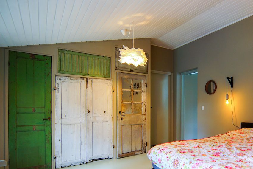 The hand made closet made of old doors