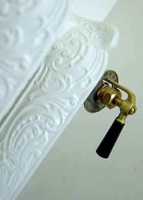 Lacquer Traditional Paint in the colour Silk White, applied on a radiator