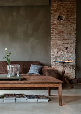 Fresco Lime paint in the colour Deep Earth, applied in the living room
